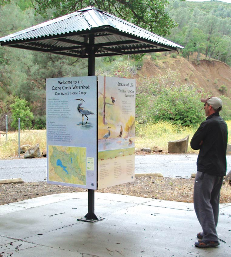 Four installed interpretive panels at Cache Creek, Yolo County, California.
